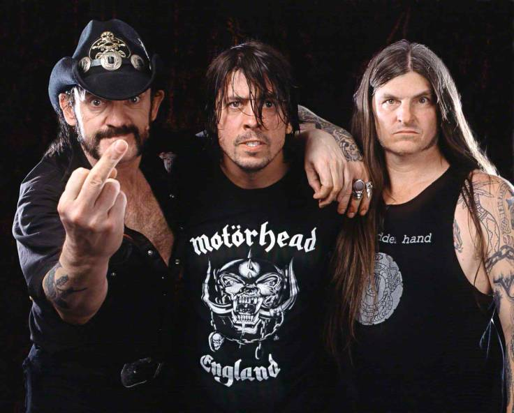 ca. 2004 --- Motorhead singer and bassist Lemmy (left) and singer Wino (right) work with Foo Fighters drummer Dave Grohl (center) on his heavy metal project, Probot. --- Image by © Dale May/Corbis Outline
